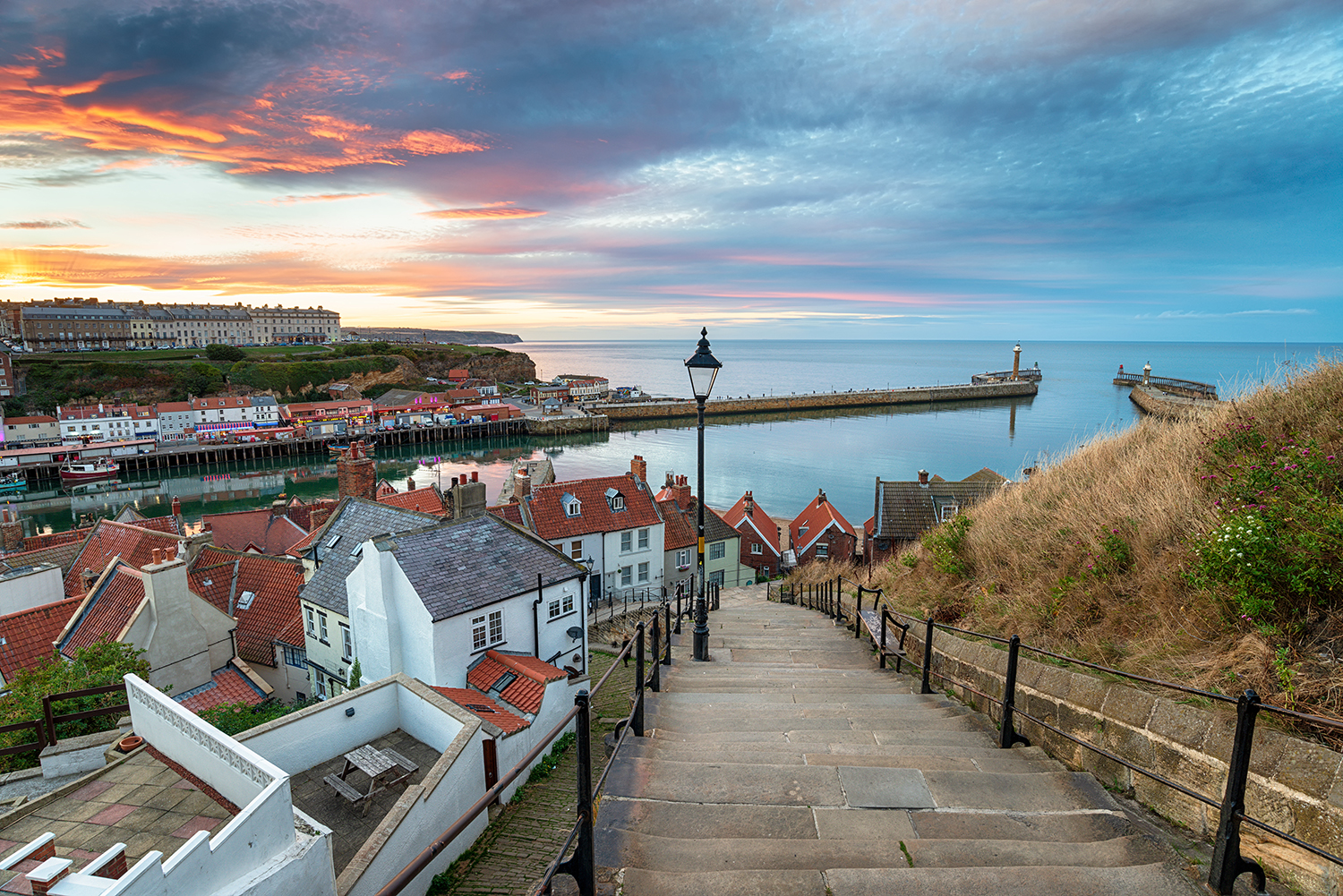 sun setting over Whitby harbour